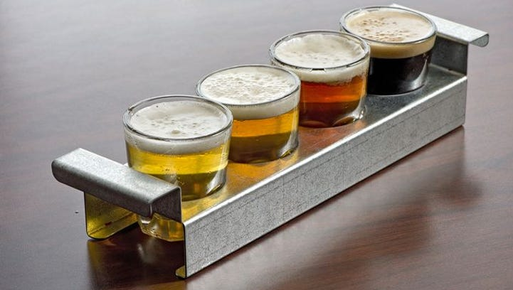 A flight of beer at the original Tap & Screw location