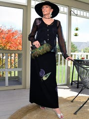 Iris Prager of Milton models several outfits at her home Friday Nov. 6, 2015