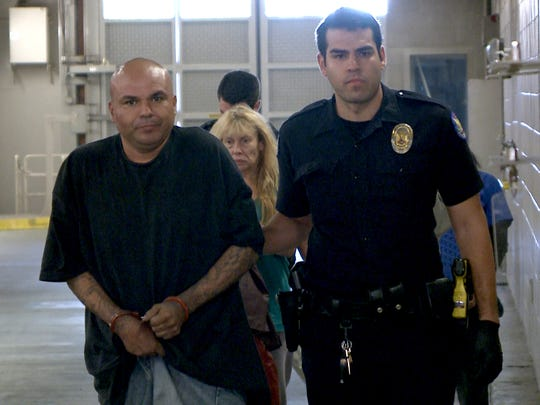 Ramon L. Bueno   on Thursday, Oct. 16, 2014, with a Phoenix police officer. Police say Bueno  is a suspect  in the shooting of a DPS officer.
