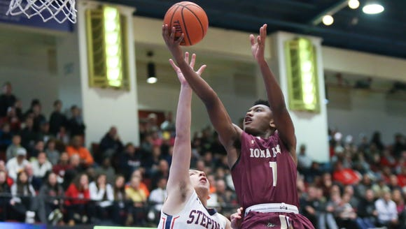 Iona's Zedrek Ferrell (1) goes up strong against Stepinac's