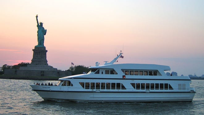 Cloud Nine passing the Statue of Liberty.
