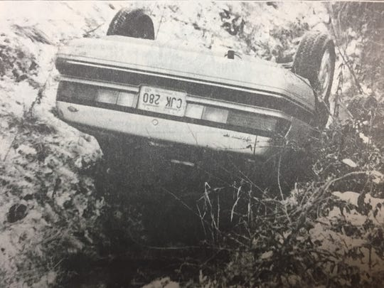 Bennie Greenwell was driving this car when he slid off the road and slid into a ditch due to snow and ice the week of January 2nd, 1991. Greenwell escaped by breaking out the rear window of the car. At least 10 roads in the county were listed as partially or completely impassable that week.