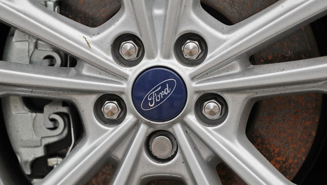 A Ford logo is seen on a wheel at a car store in London, Tuesday, Aug. 22, 2017.  Car manufacturer Ford is offering car buyers in Britain a 2,000-pound ($2,570) incentive to trade in older vehicles for new, less polluting models. (AP Photo/Frank Augstein)