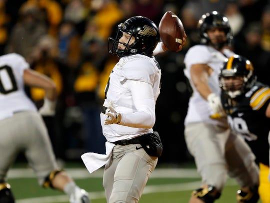 Purdue quarterback Elijah Sindelar throws a pass during the second half of an NCAA college football game against Iowa, Saturday, Nov. 18, 2017, in Iowa City, Iowa. Purdue won 24-15. (AP Photo/Charlie Neibergall)