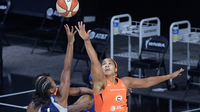 Minnesota Lynx guard Lexie Brown (4) goes up to shoot in front of Connecticut Sun center Brionna Jones during the Lynx's win on Sunday in Bradenton, Fla.