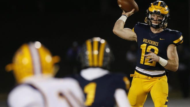 Prince Avenue's Brock Vandagriff (12) throws a pass to Prince Avenue's Logan Johnson (1) during an GHSA high school football game between Prince Avenue Christian and Athens Christian in Bogart, Ga., on Friday, Nov. 20, 2020. Prince Avenue Christian won 55-9 and Vandagriff throw 7 touchdowns.