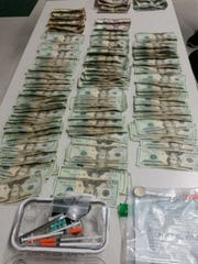 Cash and drugs were found in a car with two Fort Myers area residents, authorities said.