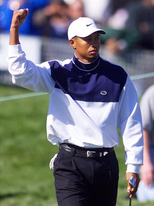 DIGITAL -- Tiger Woods pumps his fist after chipping in for birdie on the 18th hole during second round action at the Phoenix Open at the TPC Scottsdale. Woods is tied for the lead at 4-under-par. 1/29/99