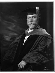 Dr. John Harvey Kellogg wears an academic robe and