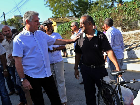 Miguel Diaz-Canel, left, who is expected to replace