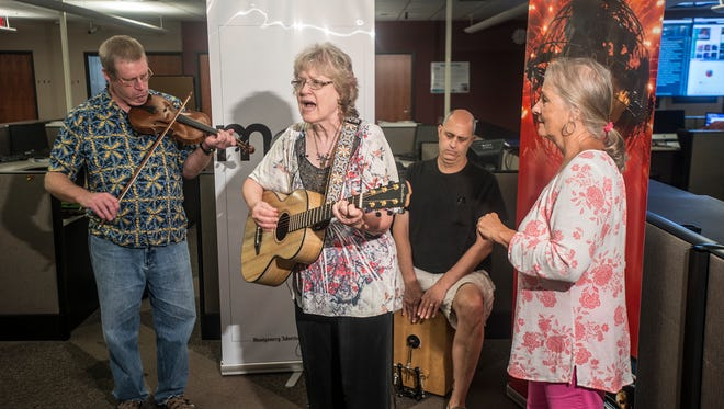 Singer and songwriter Karren Pell brought along members of her band Old Alabama Town Revue Crue to perform Tuesday, July 26, 2016, in the Montgomery Advertiser newsroom.