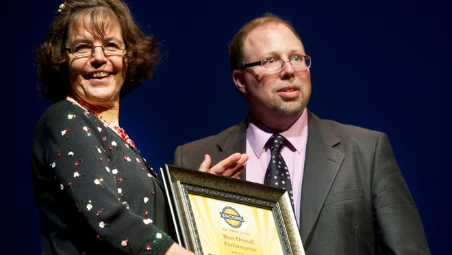 Longtime Dover Area High School director Jaci Keagy, left, and vocal coach Andrew Apgar receive an Encore award in 2013.