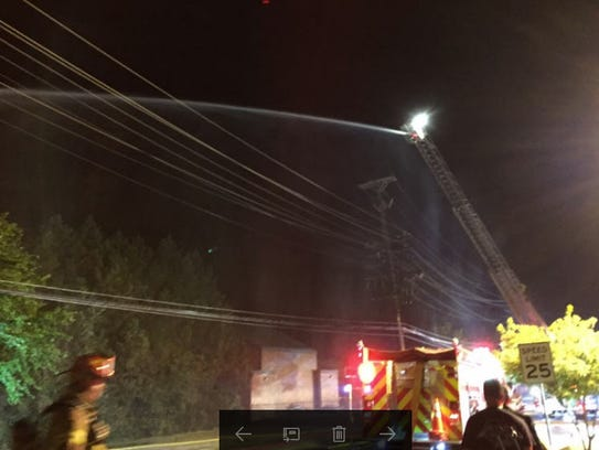 Crews work to extinguish a blaze that started as a