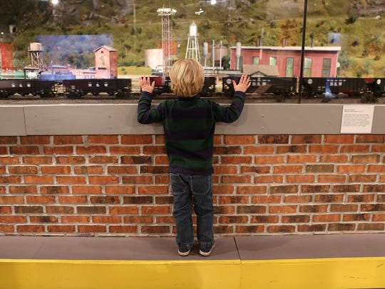 Jake Taylor, 4, checks out a train display at EnterTRAINment