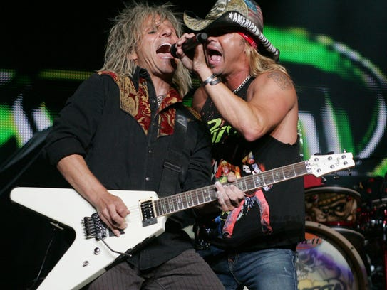 Poison's C.C. DeVille and Bret Michaels on stage at
