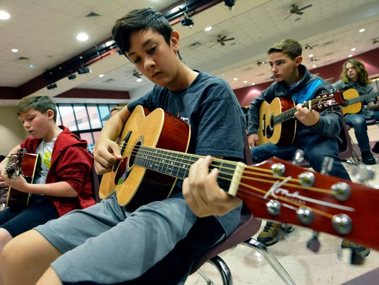 Junior High students learn the guitar