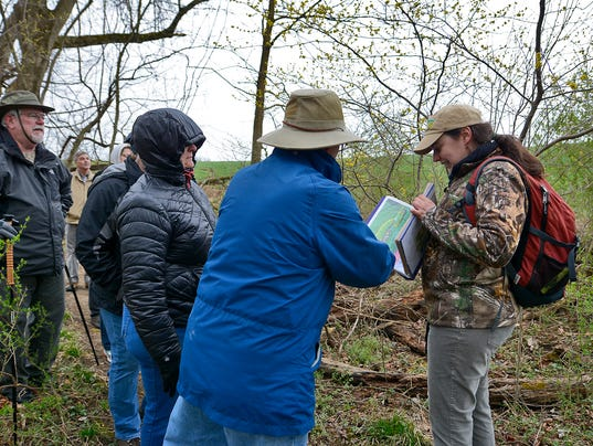 Visitors learn about Native Lands park on nature walk.