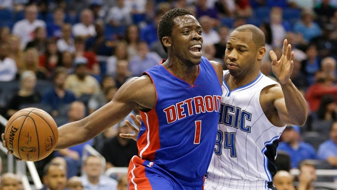 Reggie Jackson passes the ball as he gets around the Magic's Willie Green.