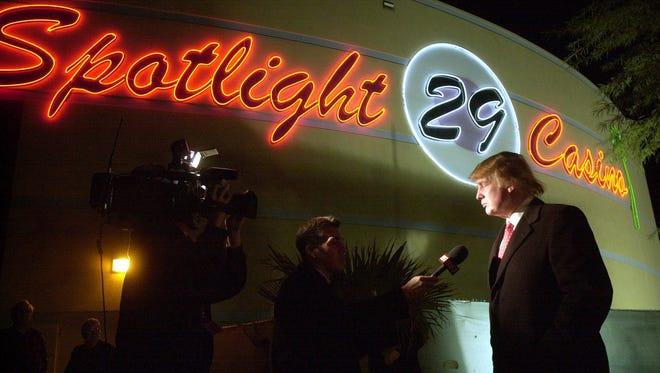 Donald Trump is interviewed by a television journalist during a visit to the Spotlight 29 Casino.