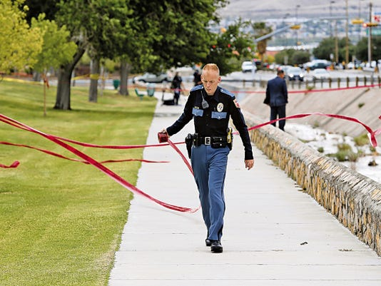Police investigate a body found in a drainage ditch at Sunland Park and Chermont drives Tuesday evening.
