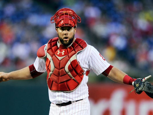 Philadelphia catcher Cameron Rupp signals to the dugout during the fourth inning of Friday's game against Miami. Jeff Francoeur hit a three-run homer to lift the Phillies to a 6-3 victory against the Marlins, two of baseball's worst teams.