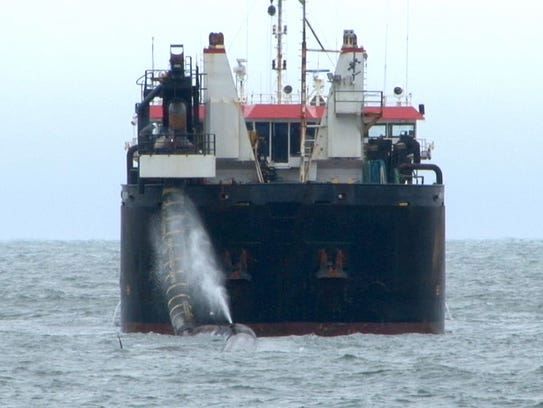 The sand replenishment ship is shown off 7th Avenue