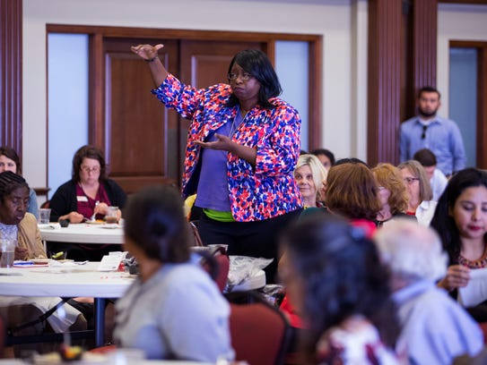 Coretta Graham offers reasons why women receive less pay than men during a workplace negotiating skills for women presentation during the YWCA Equal Pay Day event at the First United Methodist Church on Tuesday, April 10, 2018.