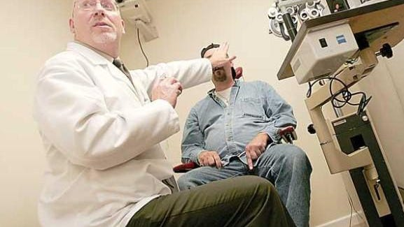 Dr. Jeffrey Liegner examines a patient at the Free Clinic Newton. Liegner, who plans to retire at the end of this month, said the need for volunteer doctors and nurse practitioners to help staff the clinic is greater than ever before.