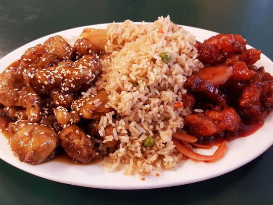 The double combo with orange chicken and sesame pork with fried rice at Wok 'N World, 519-2 E. Boutz Road.