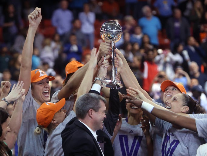 WNBA FINALS   Game 3 in Chicago -- Mercury 87, Sky 82: Phoenix celebrates after finishing off a three-game sweep of Chicago to clinch the third WNBA championship in team history.
