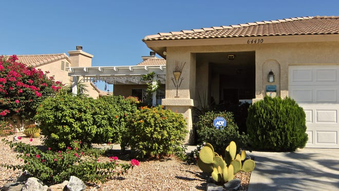 A house with drought-tolerant landscaping at Mission Lakes Country Club in Desert Hot Springs.