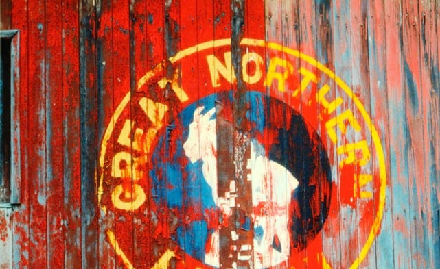 A Great Northern Railway insignia on the side of a wooden building in a photo taken by the late Jim Wylder of Phine Photography. See the Spray of the Falls column Monday for more on Wylder's fascinating life.