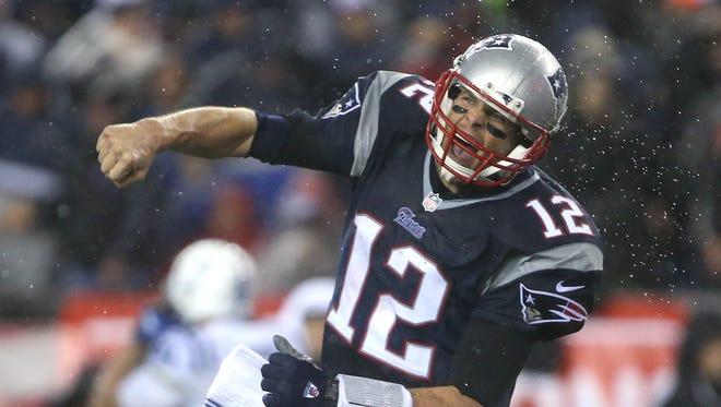 Tom Brady celebrates after a LeGarrette Blount touchdown in the fourth quarter sealed the fate of the Colts in the AFC Championship, Jan. 18, 2015.