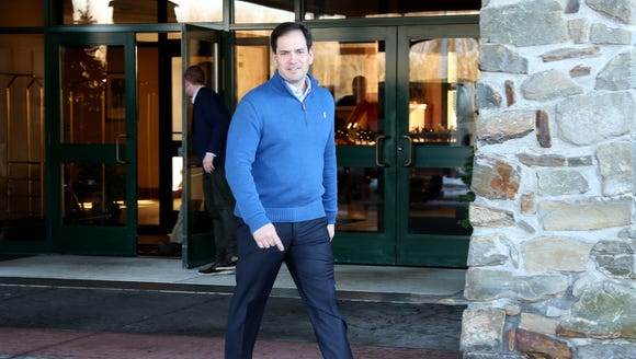 Sen. Marco Rubio, R-Fla., leaves a campaign stop in