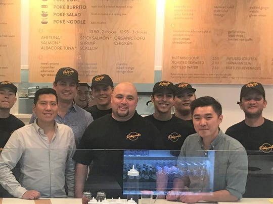 From left to right: Kasper Hsu; Jesus Reza (wearing hat, behind Hsu), El Paso Pokéworks franchise owner; Ruben Meraz, manager of El Paso Pokéworks; Peter Yang (gray shirt), and some of the employees of the new Pokeworks restaurant in West El Paso. Hsu and Yang are co-founders of the California-based chain.