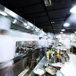 Executive chef Jared Moretti works in the kitchen at Islands Fish Grill in Indialantic.