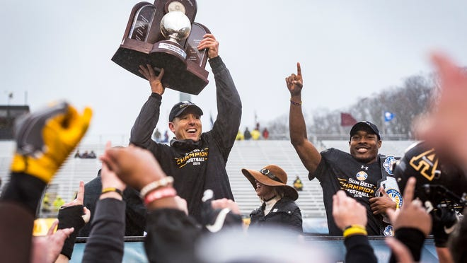 Appalachian State coach Scott Satterfield celebrates after the Mountaineers won the Sun Belt Championship on Saturday.