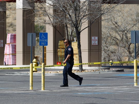 A Farmington police officer secures an area where a suspicious package was found Monday at Lowe's Home Improvement in Farmington.