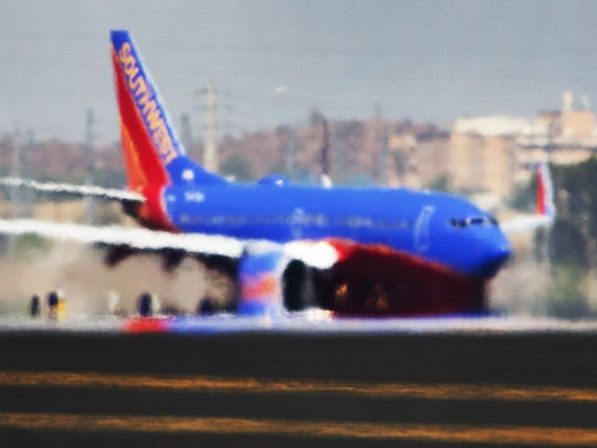 The right engine of a Southwest Airlines 737 appears