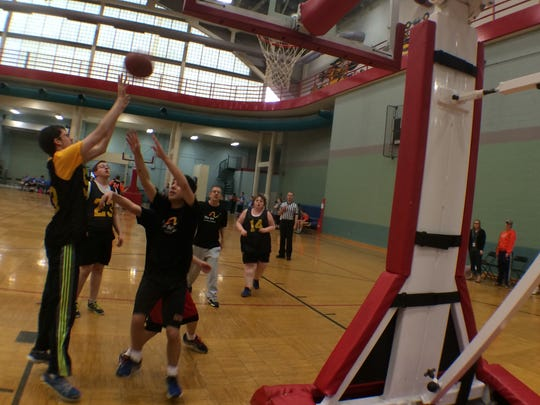 The ARC Wizards and the G-Hawk Gold square off in a developmental division bout of 2015 Mid-Winter Special Olympics Basketball Competition at the UI Field House in this file photo.