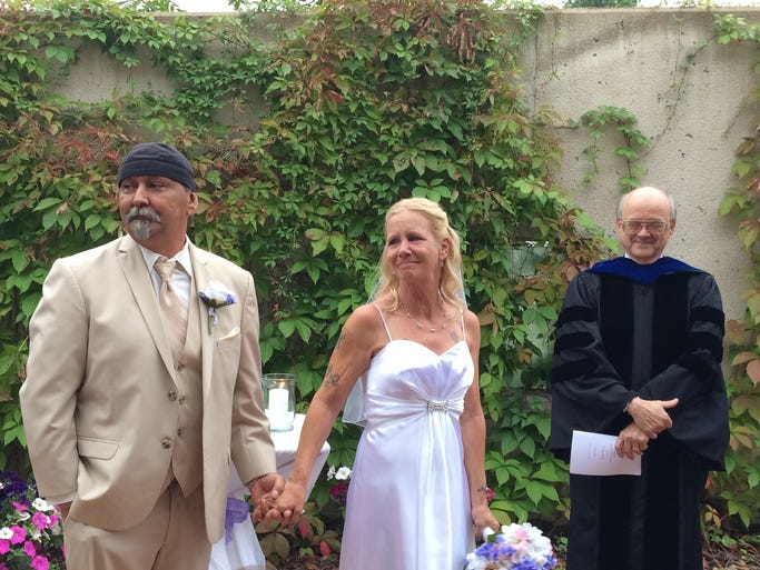 Harley Thomas, 56, who has terminal cancer, married Lori Feeley, 56, in The Cancer Team at Bellin Health's gardens on Thursday.