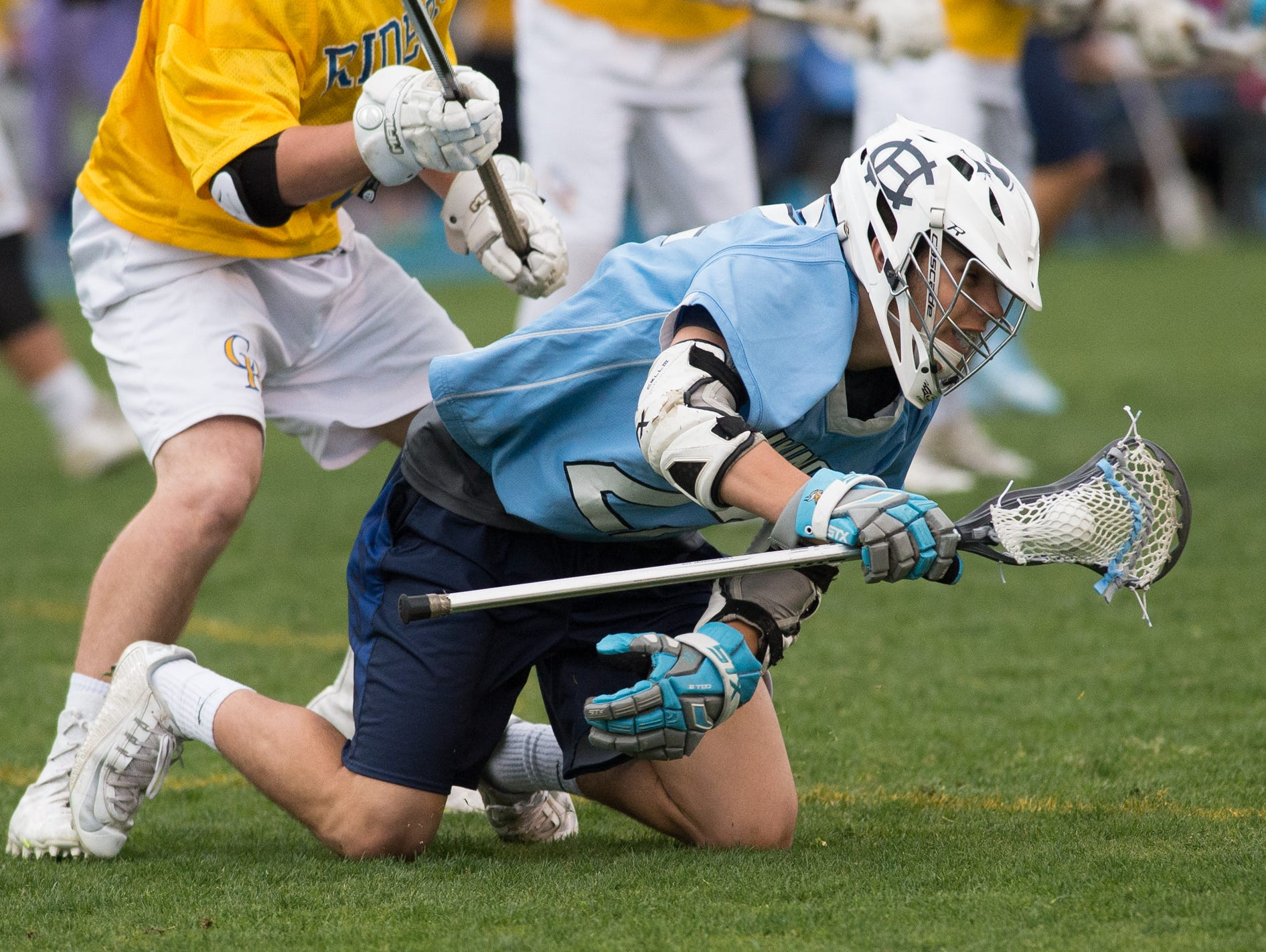 Cape Henlopen's Jacob Brown (22) falls to the ground while being pressed by Caesar Rodney's defense.