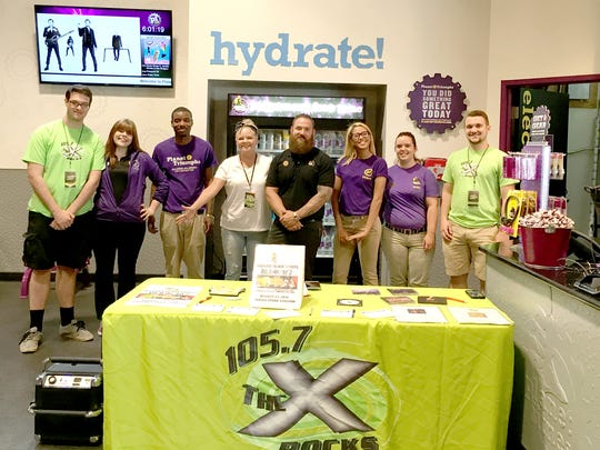 Planet Fitness staff were on hand to welcome visitors to the facility's grand re-opening celebration on June 27.