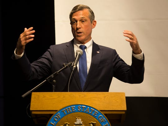 Governor John Carney explains the three sites that have been chosen as the best potential locations for Amazon's new headquarters at an bid announcement presentation Thursday at the Delaware Contemporary.