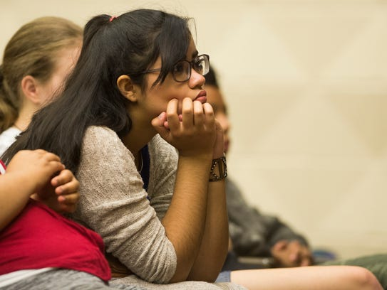A student listens to Holocaust survivor Hilda Mantelmacher,