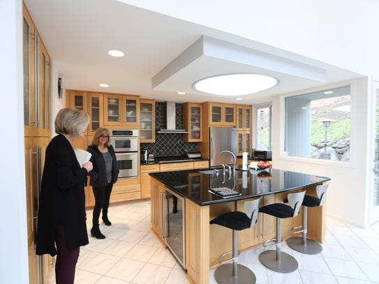 Century 21 real estate agent Rosemary McGuinn, left,
