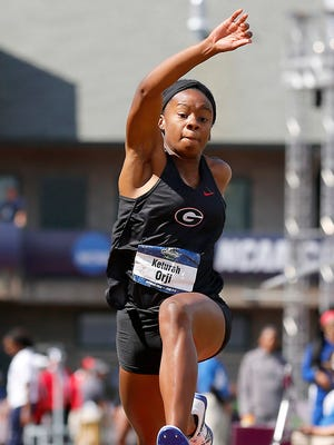 Georgia's Keturah Orji competes in the women's triple jump at the NCAA outdoor track and field championships in Eugene, Ore., Saturday, June 11, 2016. Orji won the event. (AP Photo/Ryan Kang)