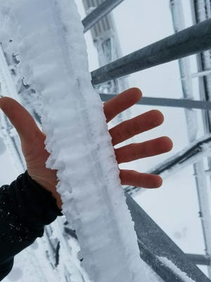 Thick ice on a telecom tower on Buck Mountain kept a crew from scaling it for days to restore internet service knocked out by lightning.