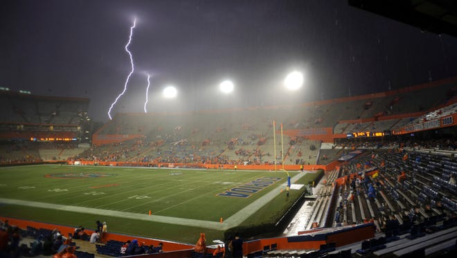 Lightning strikes near Ben Hill Griffin Stadium at Florida Field during a weather delay before an NCAA college football game between Florida and Idaho this past Saturday.