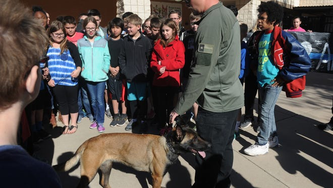 Abilene Police Officer Josh New and his K9 partner visit the fifth-graders at Austin Elementary School who raised $238 in a bake sale, matched by the PTO, and donated to the Abilene Police Foundation Friday. Students chose police as the recipients of their fundraising efforts to express gratitude about the help police rendered to one of the fifth-grade teachers whose husband was recently murdered.